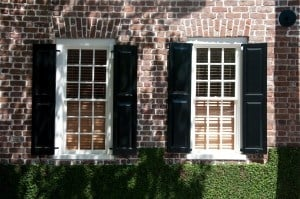 Black Shutters On A Brick Home